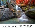 waterfall beautiful in rain... | Shutterstock . vector #1112320130