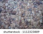 texture of a stone wall the... | Shutterstock . vector #1112323889