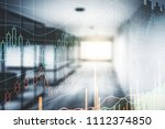 forex chart on blurry office... | Shutterstock . vector #1112374850