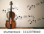 violin with notes on concrete... | Shutterstock . vector #1112378060