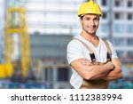 smiling craftsman on building... | Shutterstock . vector #1112383994
