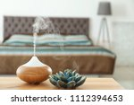 aroma oil diffuser on table at... | Shutterstock . vector #1112394653