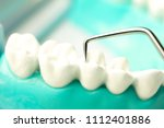 dentist cleaning teeth with... | Shutterstock . vector #1112401886