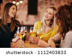 girlfriends drinking wine and... | Shutterstock . vector #1112403833
