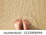 man foot near sea foam  gold... | Shutterstock . vector #1112406944