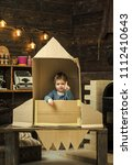 childhood concept. kid sit in...   Shutterstock . vector #1112410643