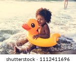 african little boy playing at... | Shutterstock . vector #1112411696