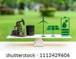 fossil fuel vs renewable  ... | Shutterstock . vector #1112429606