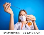girl in a medical suit holds a ... | Shutterstock . vector #1112434724
