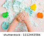 childs hands with sand | Shutterstock . vector #1112443586