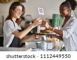 waitress handing order of food... | Shutterstock . vector #1112449550