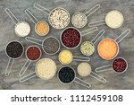 dried health food in scoops of... | Shutterstock . vector #1112459108