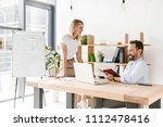 couple of colleagues discussing ... | Shutterstock . vector #1112478416