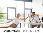 couple of happy colleagues... | Shutterstock . vector #1112478476