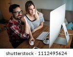 young attractive designers... | Shutterstock . vector #1112495624