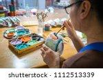 close up hands holding a bowl...   Shutterstock . vector #1112513339