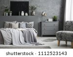 grey armchair near cabinet and... | Shutterstock . vector #1112523143