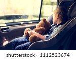 a little girl in a car seat   Shutterstock . vector #1112523674
