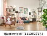 white pillow on pink armchair... | Shutterstock . vector #1112529173