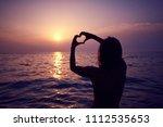 heart shape made with hands ... | Shutterstock . vector #1112535653