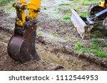 mechanical shovel at work on... | Shutterstock . vector #1112544953