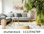 pouf and wooden table in modern ... | Shutterstock . vector #1112546789