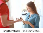 woman signing on tablet for...   Shutterstock . vector #1112549258