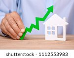 rising house prices. man is... | Shutterstock . vector #1112553983
