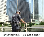 Small photo of NEW YORK, USA - May 24, 2018: NYPD counter terrorism officer providing security on the streets of Manhattan.