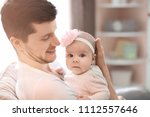 young father with baby at home | Shutterstock . vector #1112557646