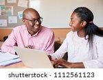high school tutor giving female ... | Shutterstock . vector #1112561123