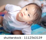 1 year old asia baby girl  | Shutterstock . vector #1112563139