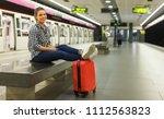 modern girl traveler waiting... | Shutterstock . vector #1112563823