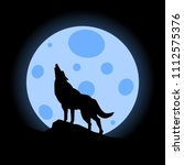silhouette of wolf howling at... | Shutterstock .eps vector #1112575376