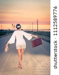 awoman walking barefoot in the... | Shutterstock . vector #1112589776