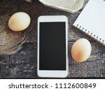 smart phone and eggs | Shutterstock . vector #1112600849