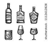 best whiskey bottles and cups... | Shutterstock .eps vector #1112612828