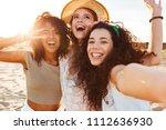 three cheerful girls friends in ... | Shutterstock . vector #1112636930