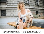 young woman with pet dog... | Shutterstock . vector #1112650370