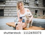 young woman with pet dog... | Shutterstock . vector #1112650373