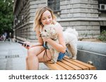 young woman with pet dog... | Shutterstock . vector #1112650376