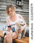 young woman with pet dog... | Shutterstock . vector #1112650379