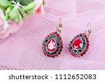 beautiful earrings  on a pink...   Shutterstock . vector #1112652083
