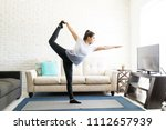 young woman in living room... | Shutterstock . vector #1112657939