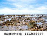 Stones On The Beach. Piles Of...