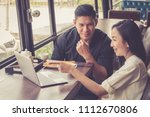 couple using laptop while... | Shutterstock . vector #1112670806