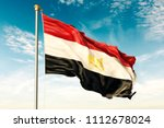 egypt flag on the blue sky with ... | Shutterstock . vector #1112678024