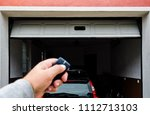 garage door pvc. hand use... | Shutterstock . vector #1112713103