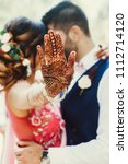 bride reaches out her hand with ... | Shutterstock . vector #1112714120