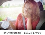 woman suffering from motion... | Shutterstock . vector #1112717999